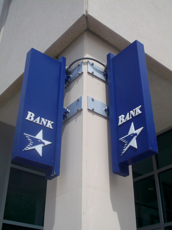Non-illuminated, double-face American National Bank projecting signs located downtown