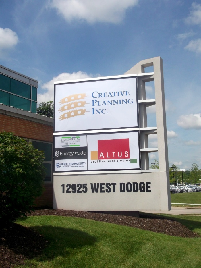 Illuminated, double-face tenant monument sign at 12925 West Dodge Road at