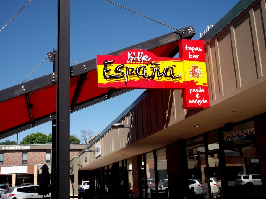 Neon illuminated, double-face projecting sign for Little Espana in Rockbrook Village