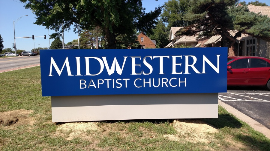 Illuminated, double-face Midwestern Baptist Church monument sign