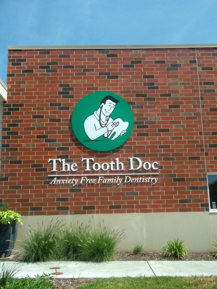 Non-illuminated flat cut out letters and logo for The Tooth Doc