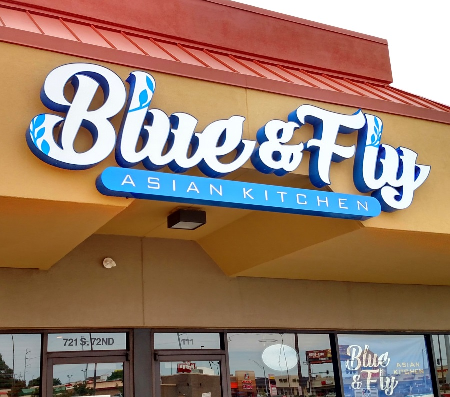 Illuminated channel letters and cabinet for Blue & Fly