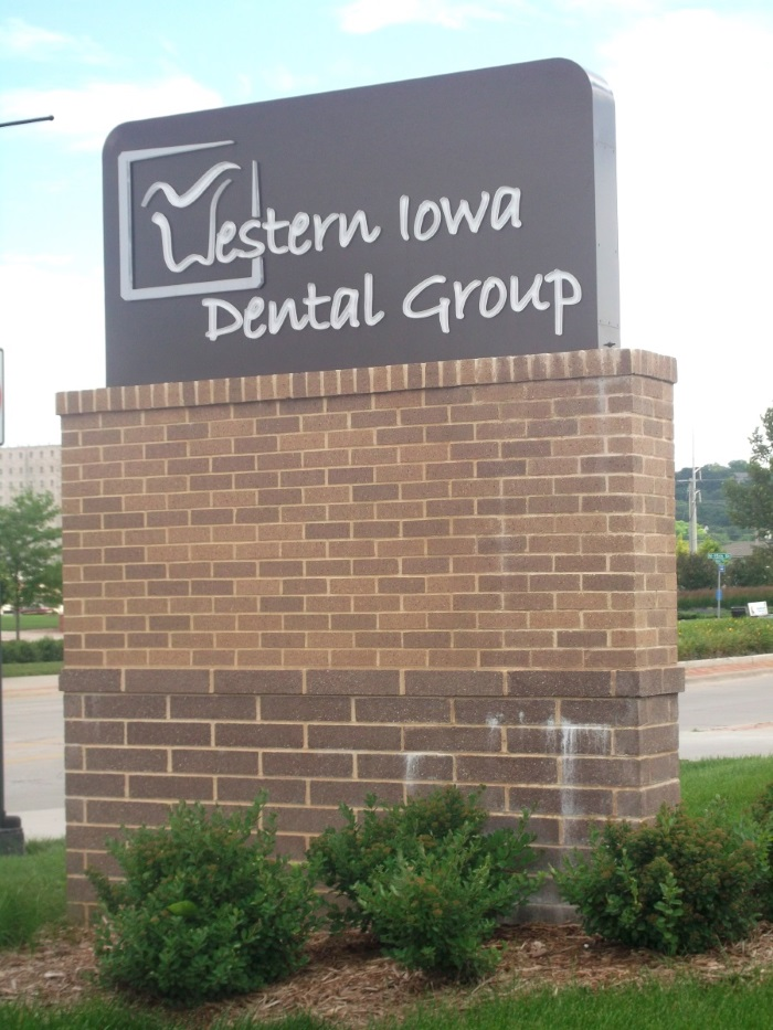 Illuminated, double-face Western Iowa Dental Group monument sign in Council Bluffs